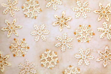 Old wooden christmas snowflake abstract design over mottled background  Stock Photo