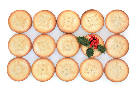 mince pie: Christmas mince pie cakes and holly over white background