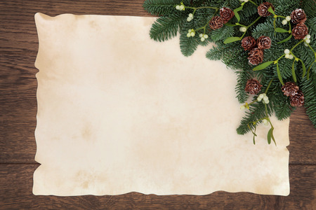 festive pine cones: Winter and christmas background border of fir, mistletoe and pine cones over old parchment paper and oak wood