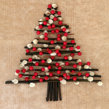 christmas pussy: Abstract christmas tree with red bauble decoration and pussy willow twigs over brown paper background  Stock Photo
