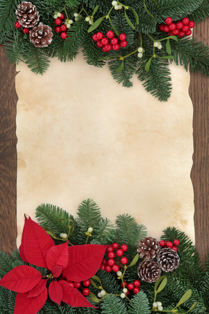 old fashioned christmas: Winter and christmas floral border with poinsettia flower, bauble decorations, mistletoe and winter greenery over parchment paper and oak  Stock Photo