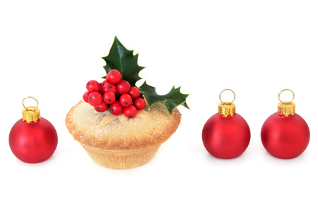 mince pie: Christmas mince pie cake with red bauble decorations and holly over white background.