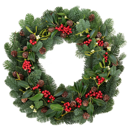 christmas greetings: Winter and christmas floral wreath with holly, ivy, mistletoe and spruce fir over white background