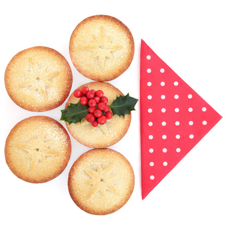 mince pie: Christmas mince pie cakes and holly with red serviette over white background.