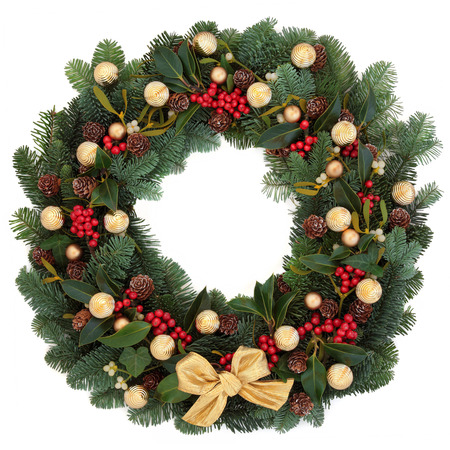 christmas greetings: Christmas and winter wreath with gold bauble decorations,holly, ivy, mistletoe, spruce fir and pine cones over white background. Stock Photo