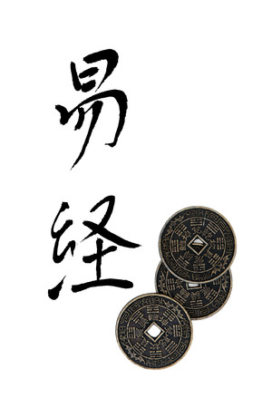 I ching coins with chinese calligraphy script, translation reads as I ching. photo