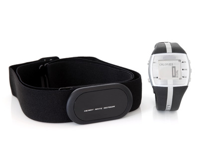 Heart rate monitor sensor and calorie counter watch over white background. Archivio Fotografico