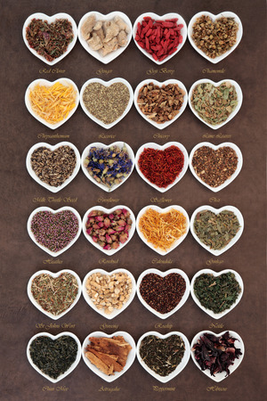 teas: Large herb tea selection in heart shaped porcelain bowls over lokta paper background with titles