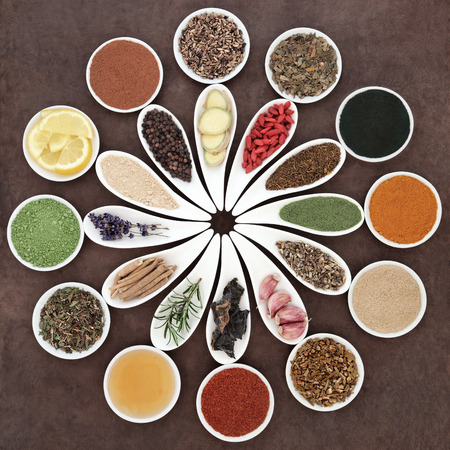 immune: Immune boosting health food selection in porcelain dishes over lokta paper background. Stock Photo