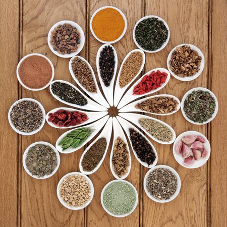 superfood: Liver detox superfood  selection in porcelain dishes over oak background.