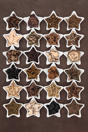 Large chinese herbal medicine selection in star shaped porcelain bowls. photo