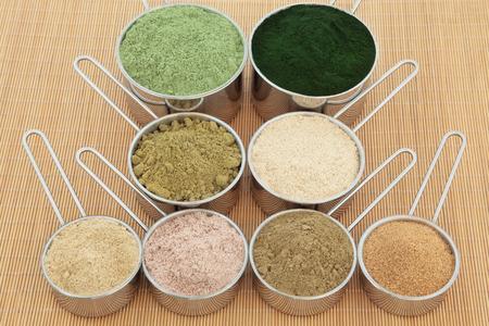 food supplement: Protein powder health food supplements in metal scoops.