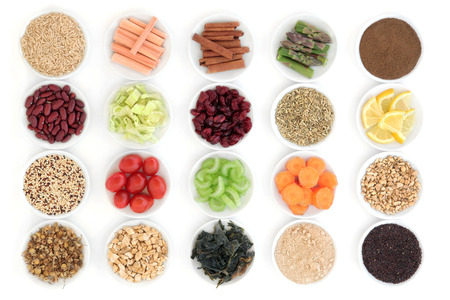 Large diet and weight loss superfood selection in porcelain bowls over white background. Archivio Fotografico