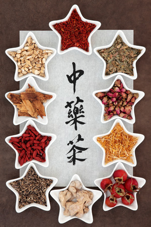 teas: Chinese herb tea selection in star shaped porcelain bowls over brown paper background with chinese calligraphy script. Translation reads as chinese herbal teas.