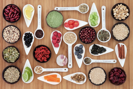 Large weight loss and diet super food selection in bowls and measuring spoons over bamboo background. Archivio Fotografico