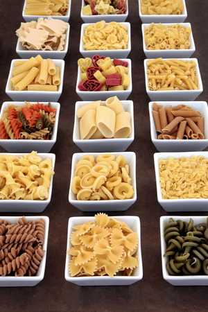 dried food: Pasta dried food varieties in white square porcelain bowls