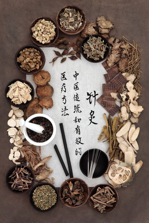 Chinese herbal medicine selection, acupuncture needles, moxa sticks and mandarin calligraphy script. Translation describes acupuncture chinese medicine as a traditional and effective medical solution. Editorial