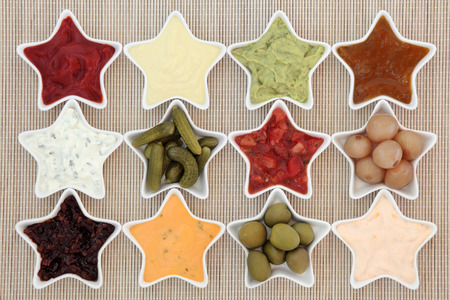 dips: Selection of dips for snacks in star shaped dishes over bamboo background.