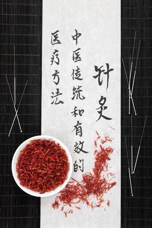 describes: Acupuncture needles and mandarin script on rice paper with safflower. Translation describes acupuncture chinese medicine as a traditional and effective medical solution.
