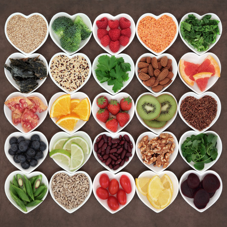 abstract heart: Super food for beauty detox health diet on white porcelain bowls.