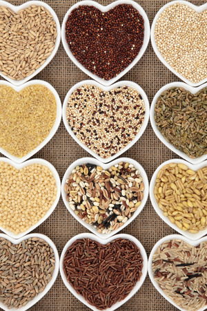 bulgur: Grain selection in heart shaped dishes over hessian background.