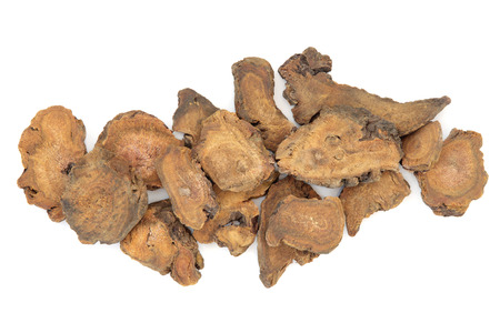 huang: Rhubarb root herb used in chinese herbal medicine over white background. Da huang.