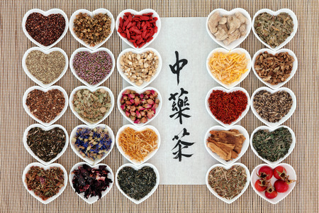 teas: Chinese herbal tea selection with calligraphy script on rice paper. Translation reads as chinese herbal tea.