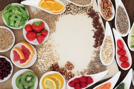 hemp hemp seed: Health food selection in porcelain bowls over natural speckled hemp paper notebook.