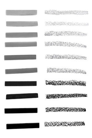 shades of grey: Charcoal drawing sticks in shades of grey with tester lines over white background.