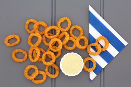 napkin ring: Onion ring snack food with mayo dip and striped napkin.