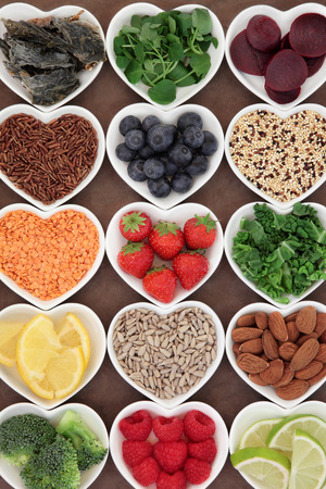 pulses: Health food for a skincare diet in heart shaped porcelain bowls. Stock Photo