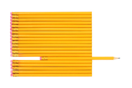 'odd one out': Lead pencils with one pencil sharpened and protruding over white background.