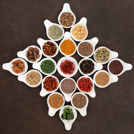 seasoning: Herb and spice seasoning selection in porcelain bowls. Stock Photo
