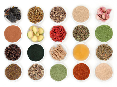 super food: Immune boosting super food selection in porcelain dishes over white background. Stock Photo