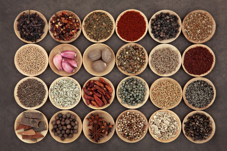 Large middle eastern spice selection in wooden bowls.