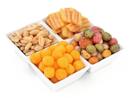 savoury: Savoury snack party food selection in square porcelain bowls over white background.