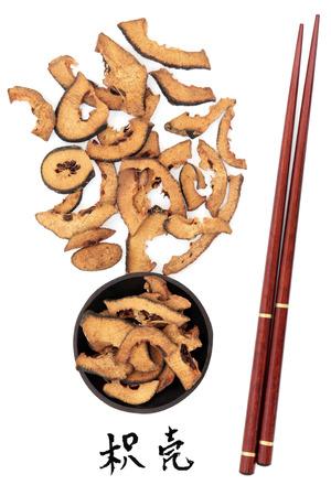 bitter orange: Bitter orange traditional chinese herbal medicine with calligraphy script and chopsticks. Zhi ke. Translation reads as bitter orange.