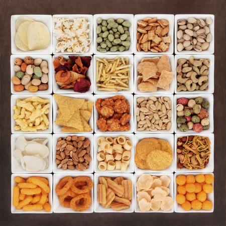 prawn: Large savoury snack food selection in square porcelain bowls. Stock Photo
