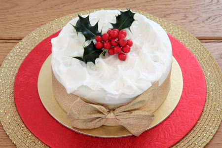 dundee: Traditional christmas cake with holly and gold bow. Stock Photo