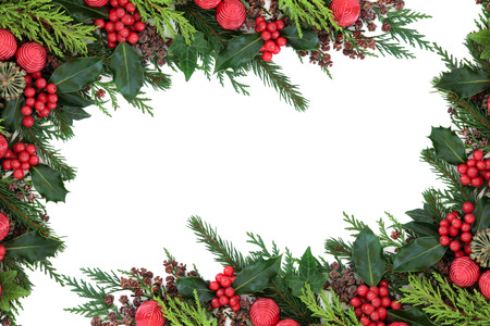 Christmas abstract background border with red bauble decorations, holly, ivy, pine cones, cedar cypress and  fir over white. Archivio Fotografico
