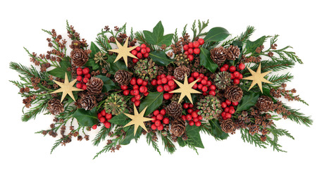 gold christmas decorations: Christmas gold star decorations, holly, mistletoe, ivy, pine cones and traditional greenery over white background.