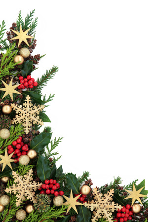 gold christmas decorations: Christmas abstract background border with gold star and snowflake bauble decorations, holly, ivy and fir over white.