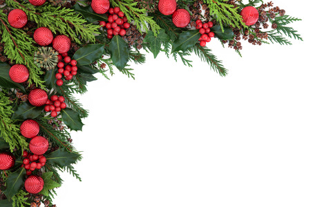 christmas ivy: Christmas abstract background border with red bauble decorations, holly, ivy, pine cones, cedar cypress and  fir over white. Stock Photo