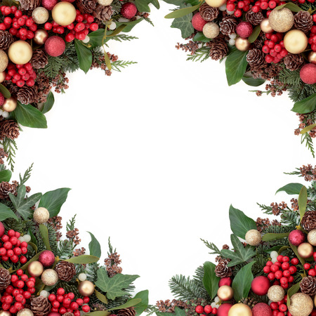 gold christmas decorations: Christmas red and gold bauble decorations, holly, mistletoe, ivy, pine cones and traditional greenery over white background.