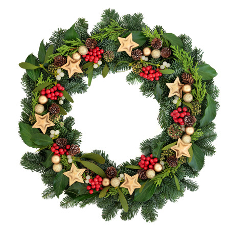 Christmas wreath with gold bauble decorations, holly, ivy, mistletoe and winter greenery over white background.