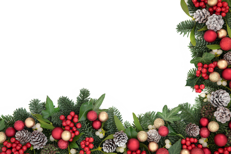 over white: Christmas background border with bauble decorations, holly, ivy, mistletoe, pine cones and blue spruce fir over white.