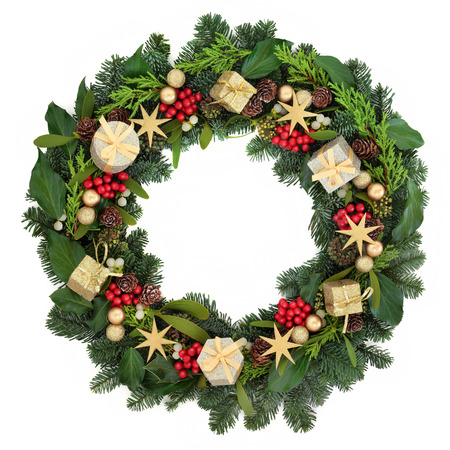 gold christmas decorations: Christmas wreath with gold bauble decorations, holly, ivy, mistletoe and winter greenery over white background.