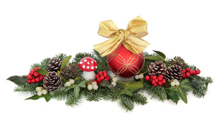 christmas bow: Christmas bauble decorations, holly, mistletoe, ivy, pine cones and traditional greenery over white background.