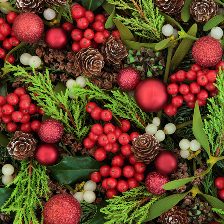 christmas baubles: Christmas abstract background with red bauble decorations, holly, ivy, mistletoe, blue spruce fir and cedar cypress greenery.