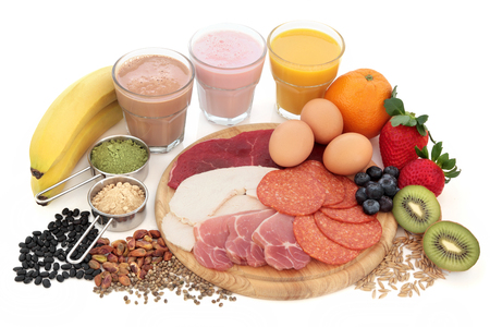 Health and body building high protein food with supplement powders, smoothies, dairy, fruit, grains, seeds, pulses and nuts over white background.